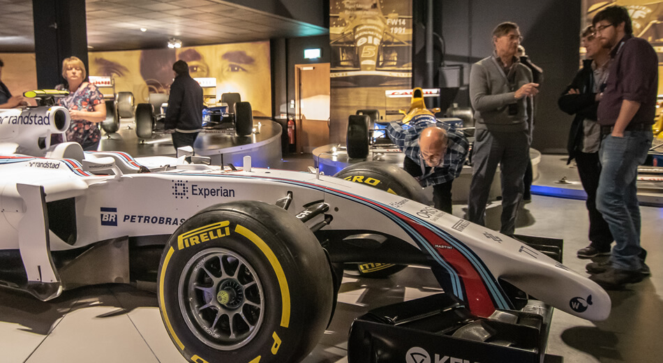 Boundless members looking at a F1 car