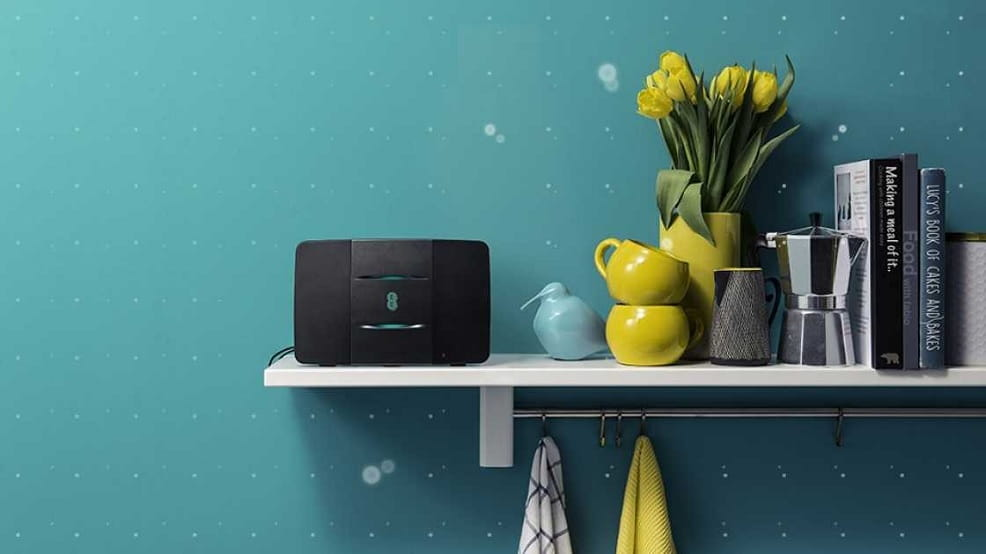 EE home hub on a shelf with cups and books