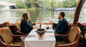 A couple on a cruise along the river Thames