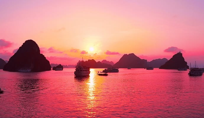 Vietnam at sunset with boats on the water