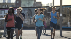 A group of people running through a city