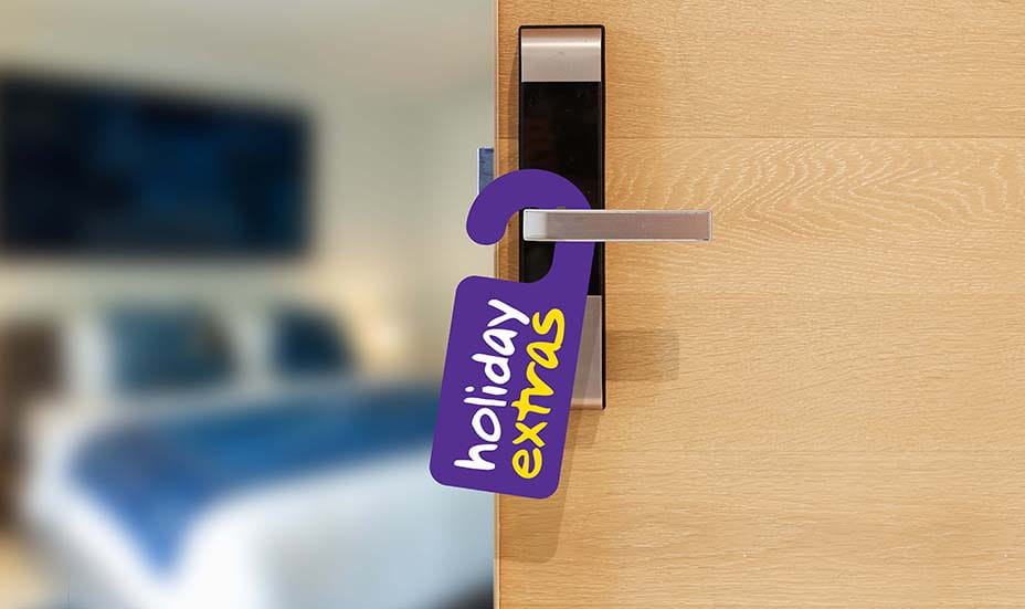 Hotel room with holiday extras on the door handle