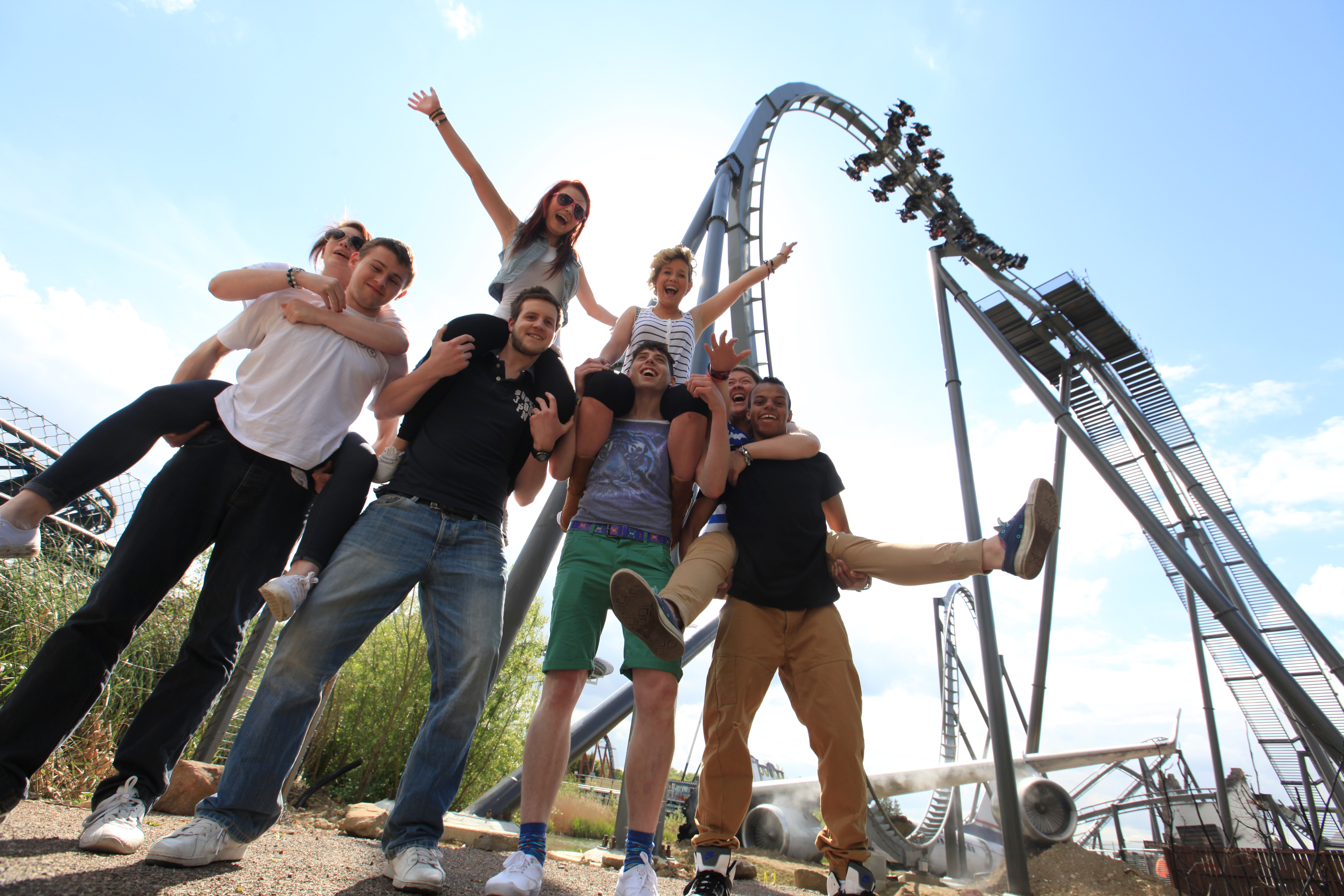 group of young people in a theme park