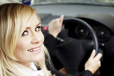 Blonde woman in car