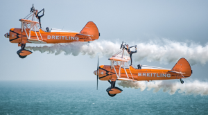 Breitling Wingwalkers flying over a shimmering sea at the Eastbourne Airshow
