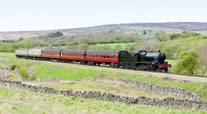 Steam train chugging through countryside