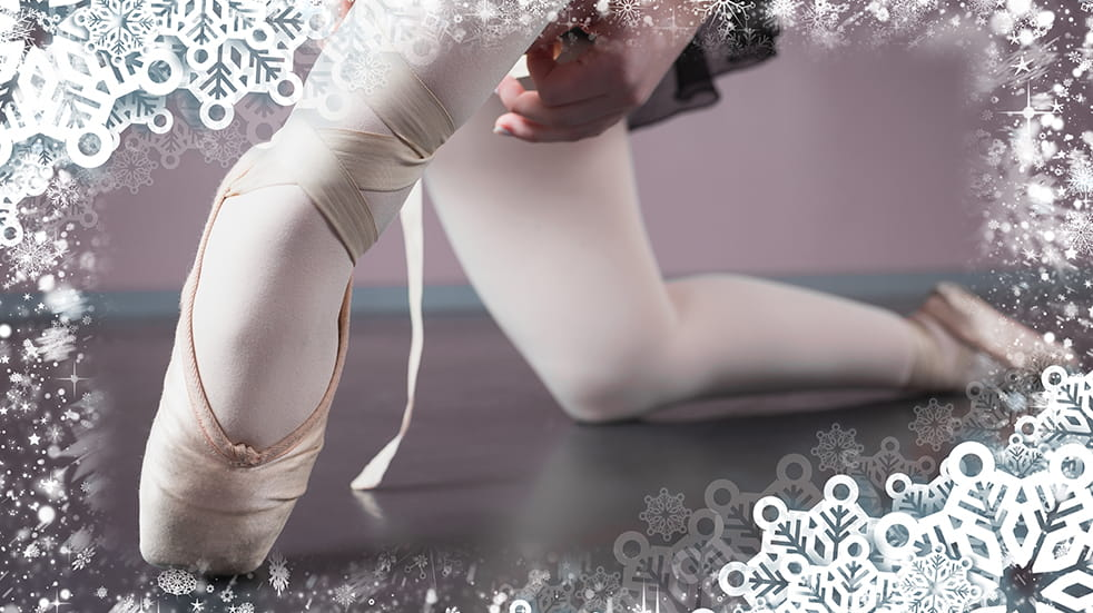 Ballerina framed with festive frost