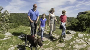 Family walking on the hills of Cheddar Gorge