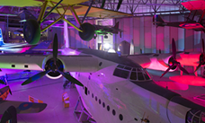 Plane in the hanger with neon lights