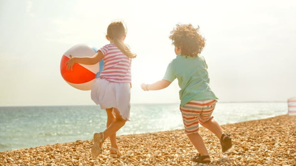 Children with a beach ball