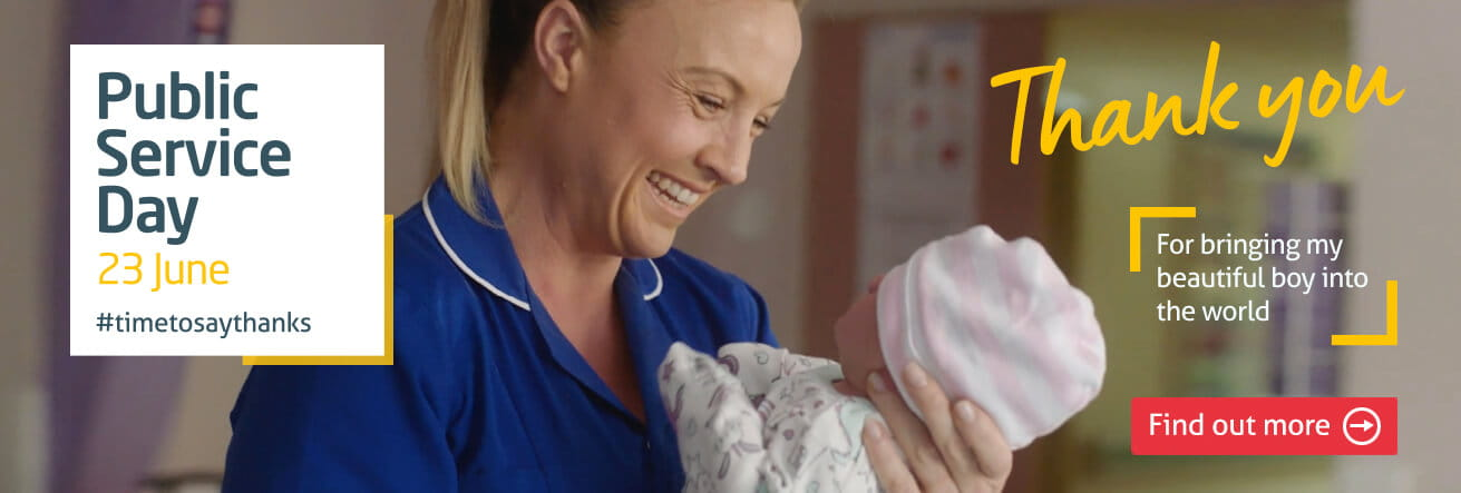 Midwife smiling at newborn baby