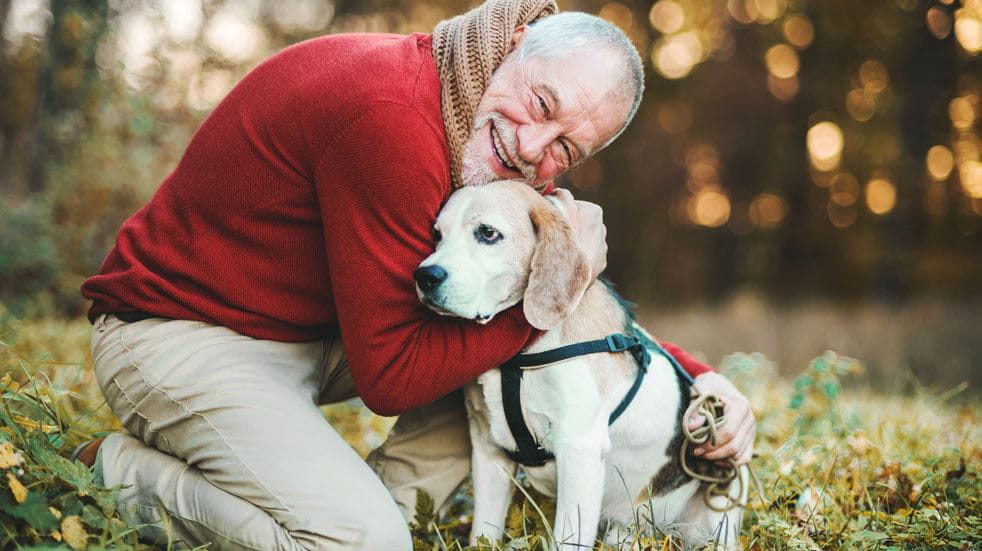 Why having pets at home could change your life; old man cuddling dog