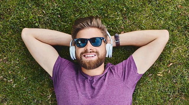man lying down listening to music