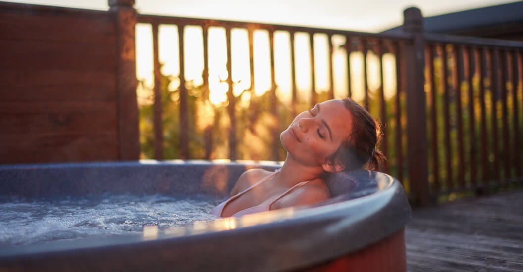 Woman relaxing in a hot tub