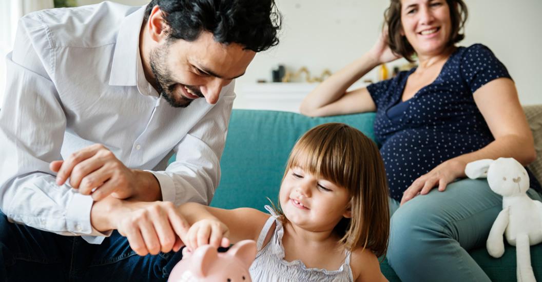 Family saving money in a piggybank